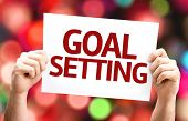 Goal Setting card with colorful background with defocused lights