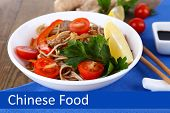 Chinese Food, tasty noodles in bowl with vegetables and space for your text