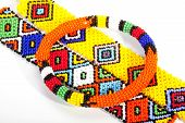 Circular Beaded Zulu Armband Atop Two Wristbands