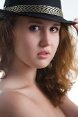 Sensual Girl In A Hat With A Beautiful Naked Body.