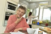 Smiling elderly woman at home with homecare