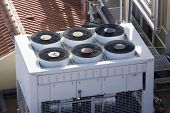 stock photo of air compressor  - View of a huge group of air conditioning on a roof - JPG
