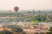 BAGAN, MYANMAR - CIRCAR MARCH 2014 : Hot air balloons fly over Bagan, recognised as amazing buddh