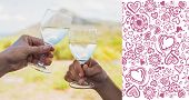 Couple clinking wine glasses outside against valentines pattern