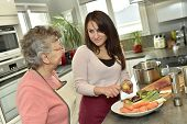 picture of handicapped  - Homecare cooking dinner for elderly woman - JPG