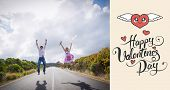 Excited couple jumping on the road against happy valentines day