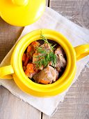 foto of stew pot  - Meat and carrot stew in a pot - JPG