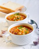 foto of indian apple  - Chunky butternut mulligatawny soup in white bowls - JPG