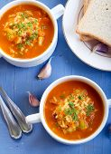 stock photo of butternut  - Chunky butternut mulligatawny soup in two bowls - JPG