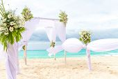 beautiful wedding arch, cabana on sand beach, outdoor beach wedding