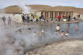 People bathe in geyser thermal water, Chile.