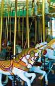 Several old-fashioned carousel horses