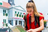 Woman got lost sightseeing with touristic map in Jakarta, Indonesia