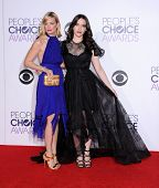 LOS ANGELES - JAN 07:  Beth Behrs & Kat Dennings arrives to the People's Choice Awards 2014  on January 7, 2015 in Los Angeles, CA