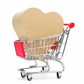 a heart-shaped gift box in a shopping cart on a white background