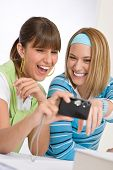 Two Young Cheerful Woman With Camera
