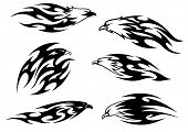 Set of stylized black and white flying eagles