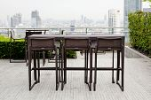 Rattan one Table With Two Stool Chairs Standing Against The Terrace