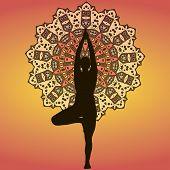 foto of hamsa  - Drawing of siluette of yogi on a orange mandala background - JPG