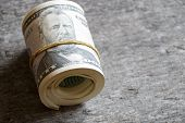 stock photo of fifties  - American Fifty Dollar Bills rolled up - JPG