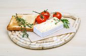 pic of brie cheese  - Soft brie cheese with rosemary thyme and toast bread - JPG