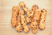 stock photo of pretzels  - pretzel nuts on rustic wooden board for frame - JPG