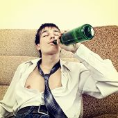 picture of lewd  - Toned Photo of Teenager drink a Beer on the Sofa at the Home - JPG