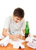 foto of compose  - Cheerful Teenager with a Beer compose a Letter on the White Background - JPG