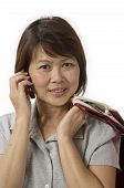 Asian Woman With Shopping Bags Talking On Her Mobile Telephone