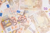 foto of fifties  - Closeup of a group of fifty euros banknote background - JPG