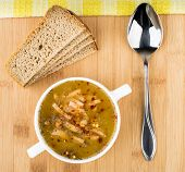 picture of tablespoon  - Pea soup with bread and tablespoon on wooden bamboo board top view - JPG