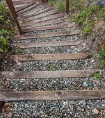 pic of stairway  - View from above a natural curving stairway made of solid wood planks and pebbles - JPG