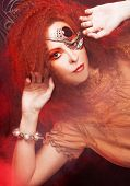 picture of woman dragon  - Smoke and young ginger woman with artistic visage - JPG
