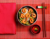 picture of rice noodles  - Vietnamese shrimp and rice noodles soup pho served on a bamboo place mat - JPG