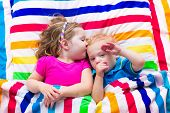 image of little young child children girl toddler  - Two kids sleeping in bed under colorful blanket - JPG