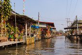 picture of street-rod  - hovels of a small village on the riverside of a canal in the thai countryside in Ratchaburi district Thailand - JPG