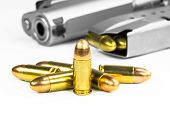 stock photo of guns  - Bullets with the gun on the white background - JPG