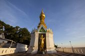 pic of peeing  - Standing gold Buddha image name is Wat Sra Song Pee Nong in Phitsanulok - JPG