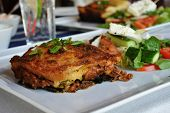 picture of lasagna  - traditional greek meat lasagna served with vegetables - JPG
