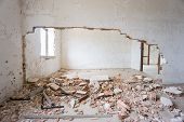 stock photo of abandoned house  - Interior of abandoned and ruined house with broken wall - JPG