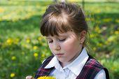 pic of dandelion  - thoughtful little girl close - JPG