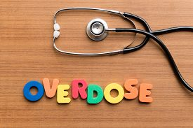 picture of overdose  - overdose colorful word on the wooden background - JPG
