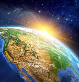 stock photo of high-rise  - Very high definition picture of planet earth in outer space with the rising sun - JPG