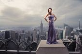 pic of snob  - Beautiful woman standing on the rooftop of a skyscraper - JPG