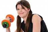 Beautiful Teen Girl Holding Colorful Weights Over White