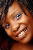stock photo of facial piercings  - beautiful smiling African woman with natural make - JPG
