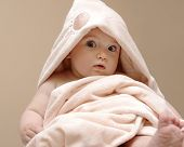 Beautiful Baby Wrapped In A Pink Blanket After Bath