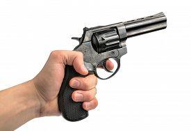 foto of revolver  - Revolver gun in hand on white background - JPG