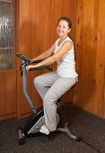 Woman Exercise On Bicycle
