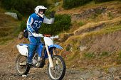 Постер, плакат: amateur motocross drivers have hobby ride on mountains road
